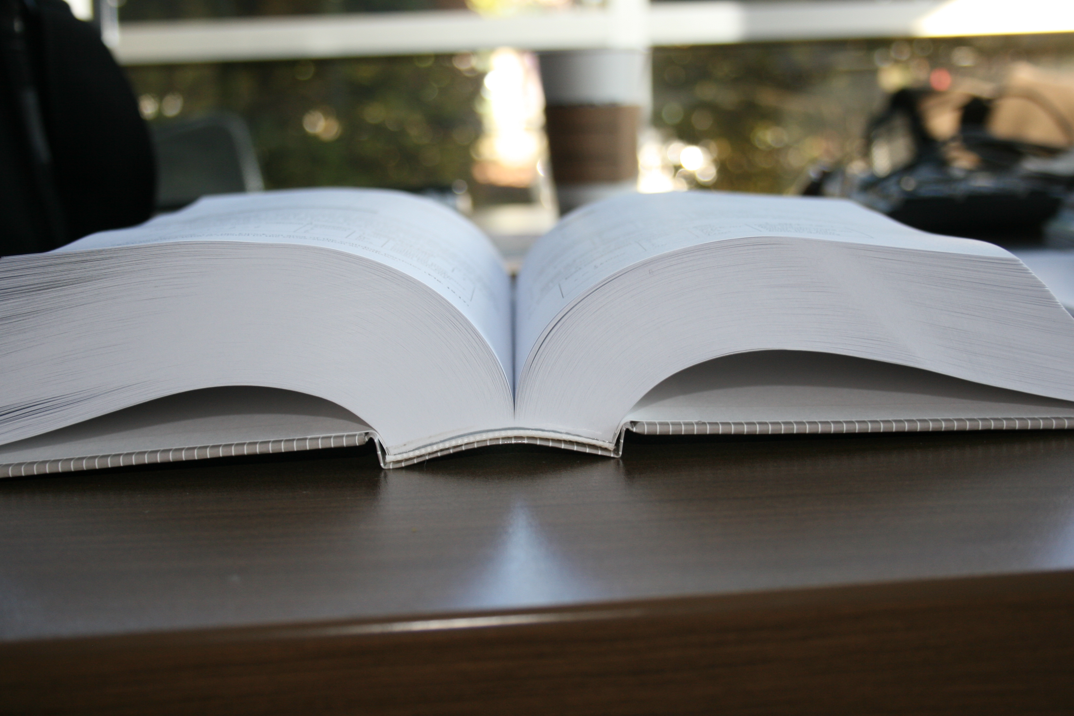 Even large page count books can be PUR bound and maintain lie-flat quality